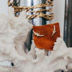 "<a href=""http://www.rilanyc.com/earrings/small-talon-studs"">Small Talon Studs</a>, from $55 (front)"