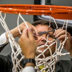 Utah Valley University Vice President Val Peterson cuts down the net to officially open the NUVI Basketball Center on the campus of Utah Valley University in Orem, Utah.