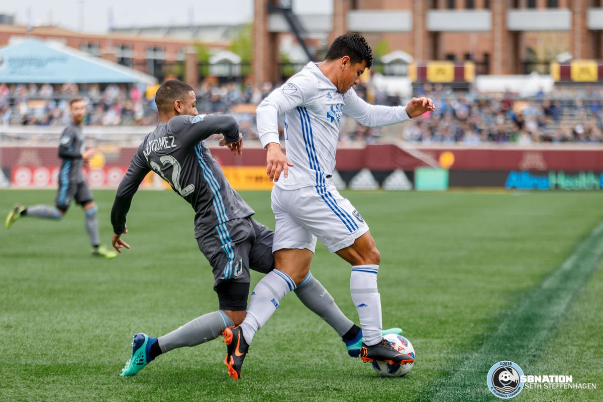 May 12, 2018 - Minneapolis, Minnesota, United States - Minnesota United defender Alexi Gomez (32) gets a foot on the ball being dribbled by San Jose defender Nick Lima (24)during the match at TCF Bank Stadium.