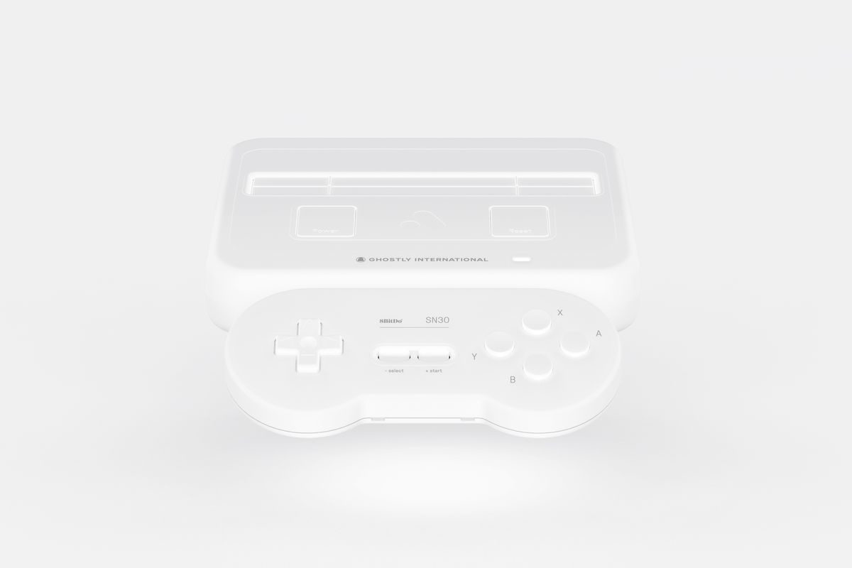 A photo of the all-white Analogue Super NT console and matching 8BitDo SN30controller on a white background.