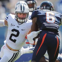 Brigham Young defensive back Dallin Leavitt (2) looks to tackle Virginia wide receiver Darius Jennings (6) as BYU and Virginia play Saturday, Sept. 20, 2014, at LaVell Edwards Stadium in Provo.