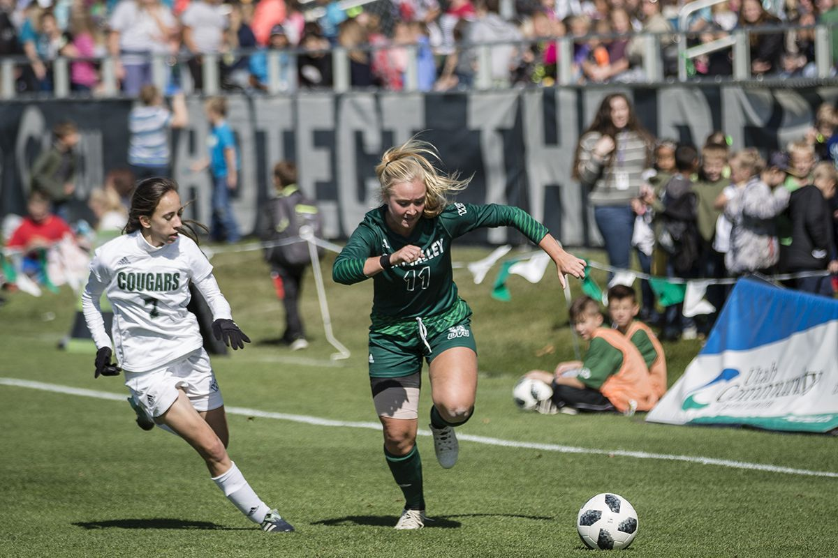 UVU redshirt freshman Sadie Brockbank (center) dribbles the ball up the field against Chicago State on Friday morning at Clyde Field.