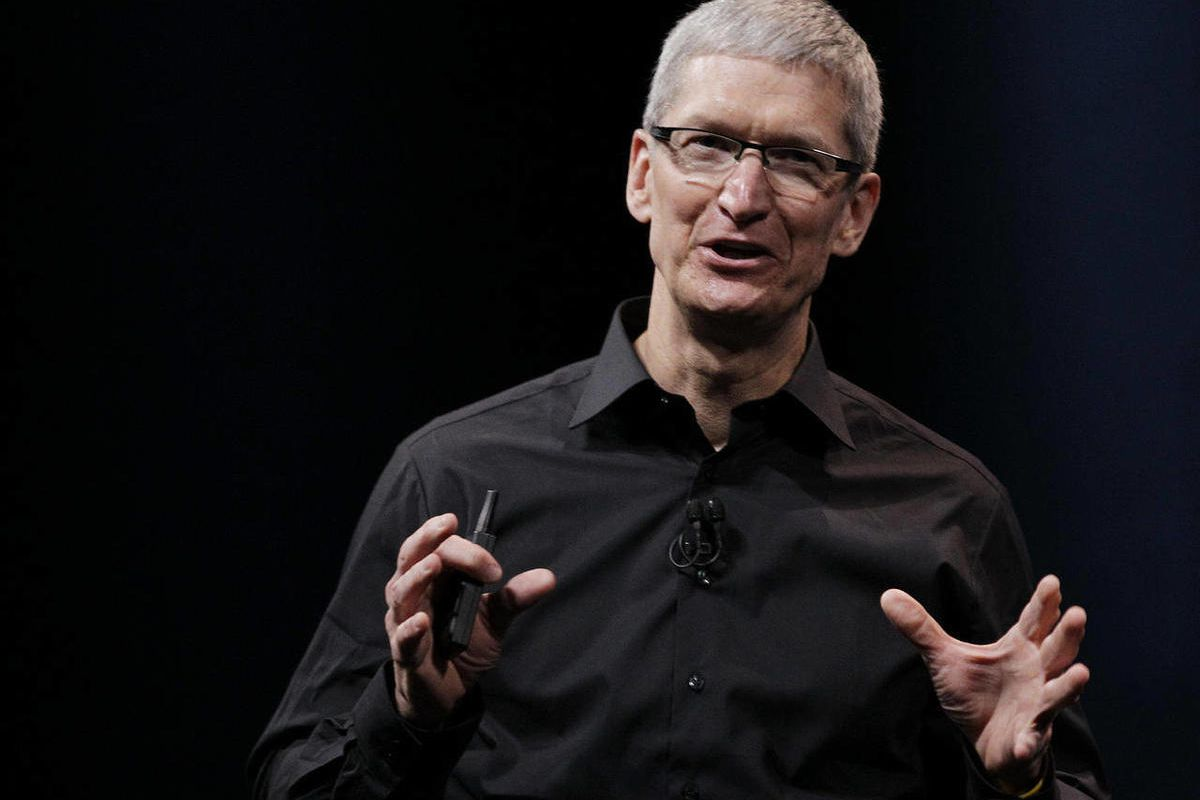 """In this Wednesday, Sept. 12, 2012 photo, Apple CEO Tim Cook speaks during an introduction of the new iPhone 5 in San Francisco. Cook says the company is """"extremely sorry"""" for the frustration that its maps application has caused and it's doing everything i"""