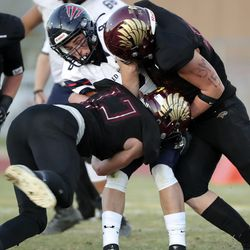 Springville's Jaxson Carvajal gets tackled by Maple Mountain's Trevin Hubbard and Drake Murdoch for a loss of 2 yards during the second round of the 5A football playoffs at Maple Mountain High School in Spanish Fork on Friday, Oct. 30, 2020. Maple Mountain won 27-21.