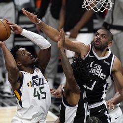 Utah Jazz guard Donovan Mitchell, left, shoots as Los Angeles Clippers forward Nicolas Batum, right, and guard Terance Mann defend during the second half of Game 3 of a second-round NBA basketball playoff series Saturday, June 12, 2021, in Los Angeles.