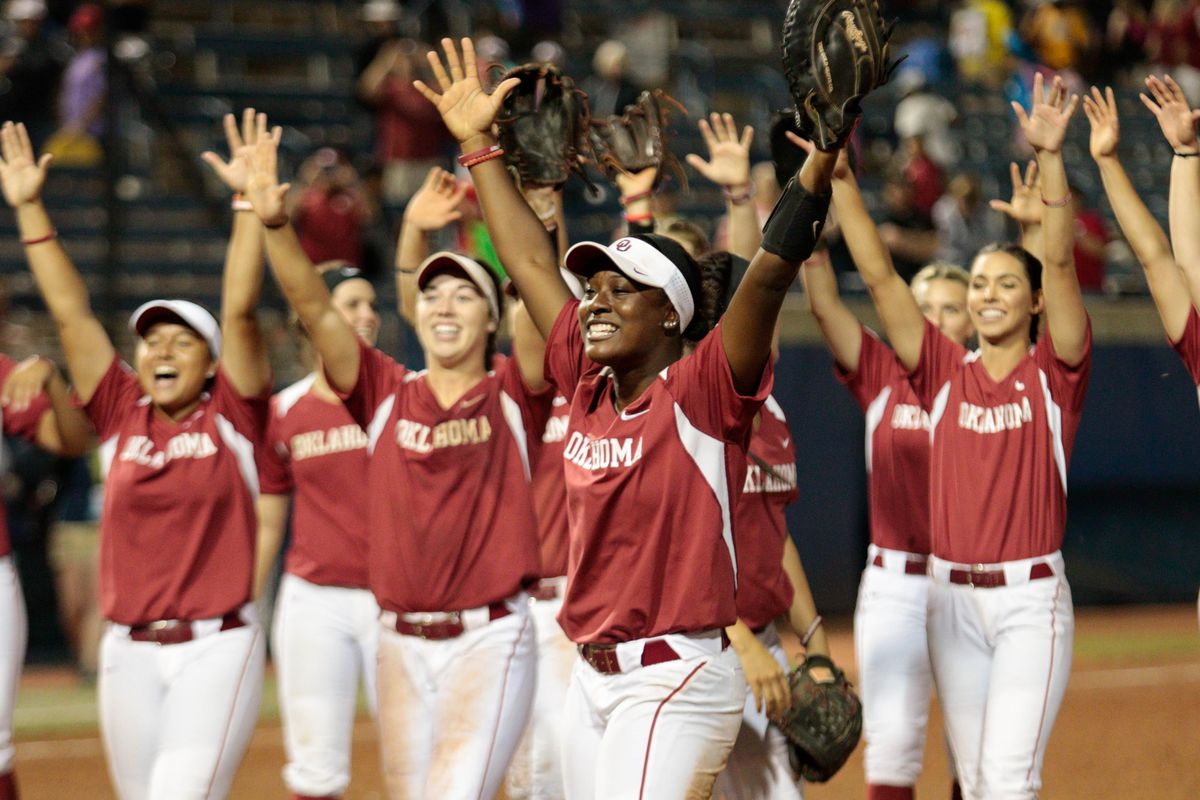 Shay Knighten celebrates with the Sooners after recording a double play