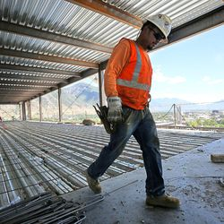 A construction worker works on the 10th floor of the new patient tower at Utah Valley Hospital in Provo on Tuesday, July 5, 2016.