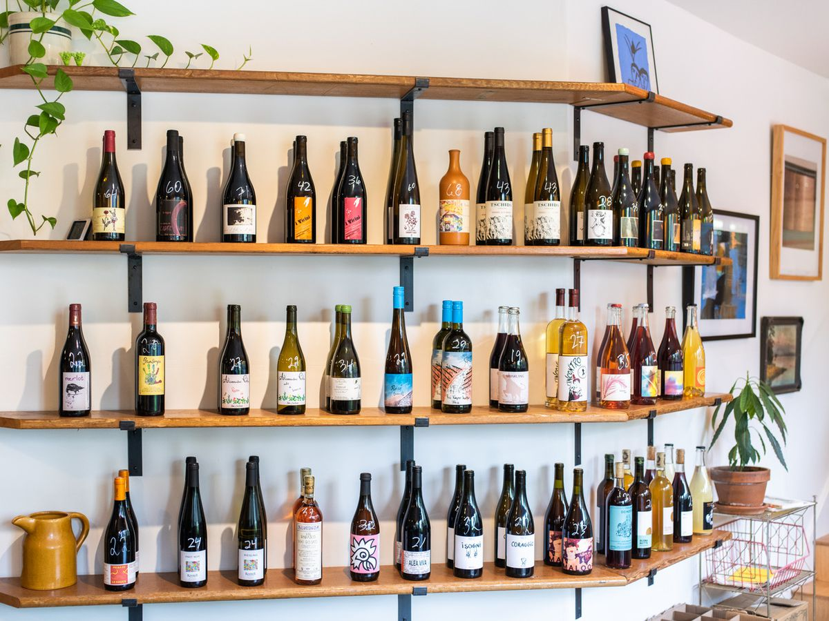 Shelves at Blotto in Seattle filled with a selection of wine and beer bottles.