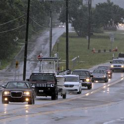 A steady stream of cars move north in the middle Keys as the Florida Keys prepare for Tropical Storm Isaac, Saturday, Aug 25, 2012. Florida Gov. Rick Scott had declared a state of emergency and a hurricane warning has been issued for the Florida Keys, as officials warn tourists to leave. (AP Photo/The Miami Herald, Walter Michot)