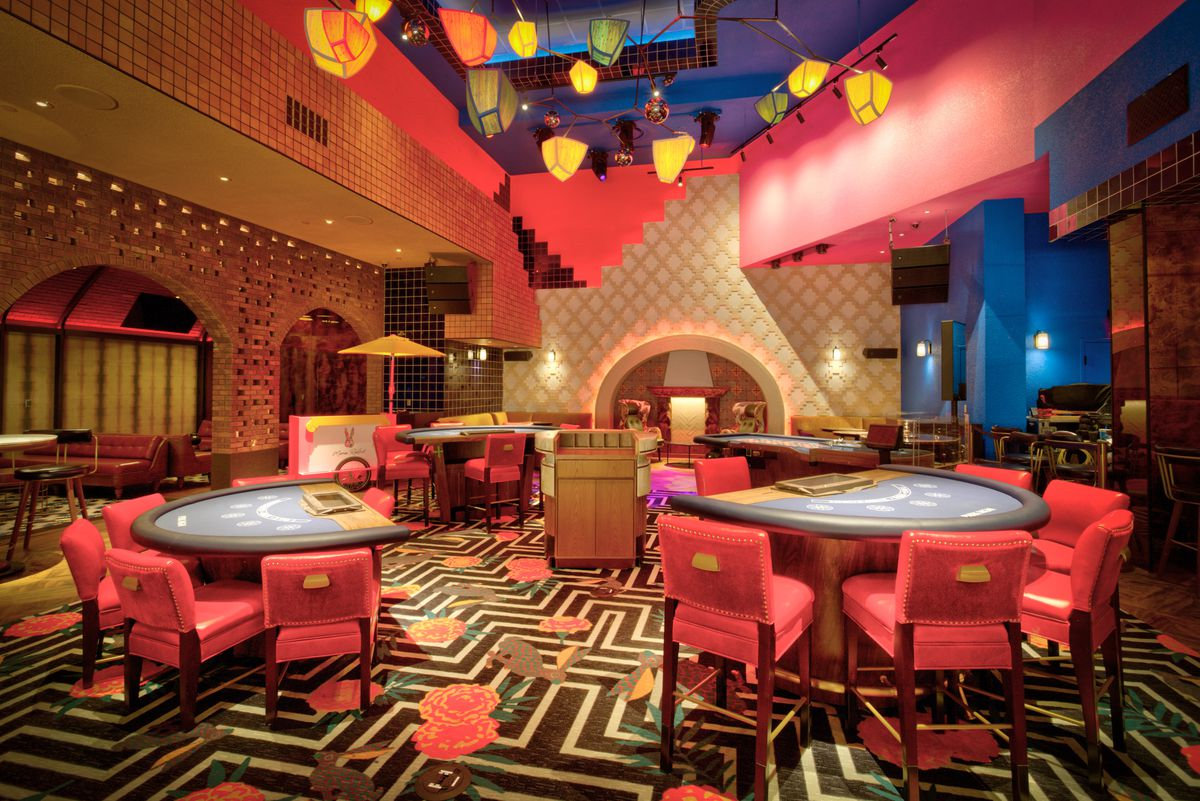 A gaming lounge decorated in pinks and blues