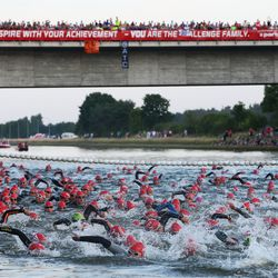 Participants compete on the swim leg during the Challenge Roth on July 20, 2014 in Roth, Germany. (Photo by Alex Grimm/Getty Images)