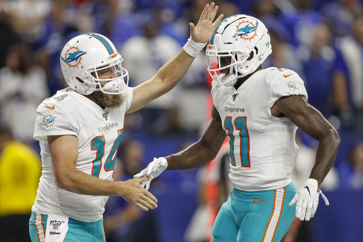 Ryan Fitzpatrick of the Miami Dolphins and DeVante Parker of the Miami Dolphins celebrate a touchdown during the first half against the Indianapolis Colts at Lucas Oil Stadium on November 10, 2019 in Indianapolis, Indiana.