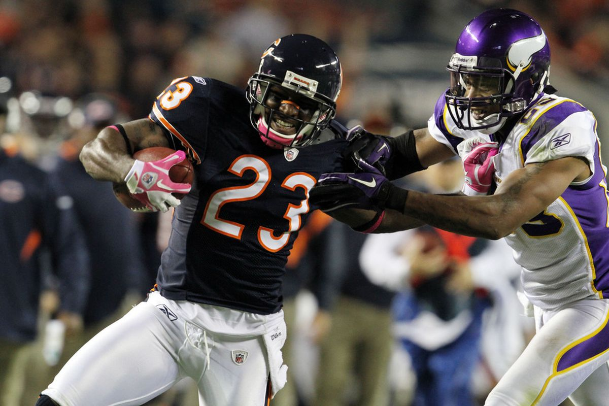 CHICAGO, IL - OCTOBER 16: Devin Hester #23 of the Chicago Bears and Cedric Griffin #23 of the Minnesota Vikings at Soldier Field on October 16, 2011 in Chicago, Illinois.  (Photo by Tasos Katopodis /Getty Images)