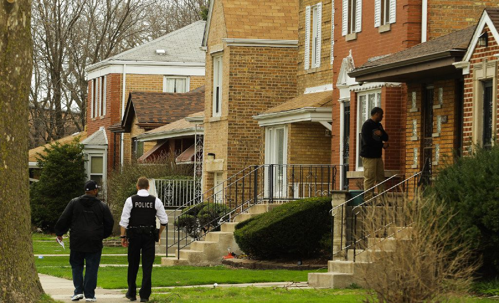 Chicago Police walk in the 9400 block of South Forest after Cook County Associate Judge Raymond Myles was fatally shot.   Leslie Adkins/For the Sun-Times