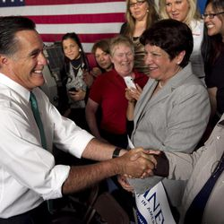 Republican presidential candidate, former Massachusetts Gov. Mitt Romney greets audience members at the conclusion of a campaign event in Hartford, Conn., Wednesday, April 11, 2012.