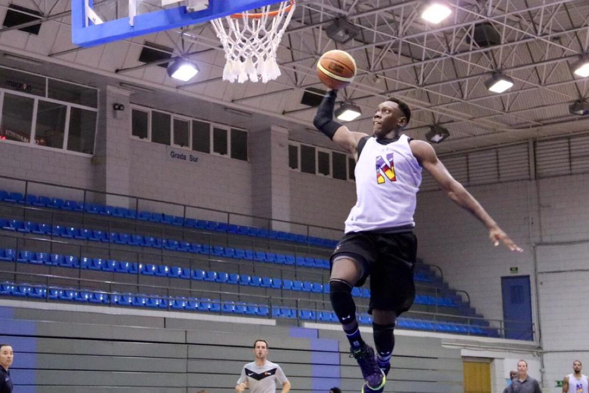 Scottie Lindsey throwing down a fastbreak dunk during NU's 94-54 win over UCAM Murcia on Thursday.