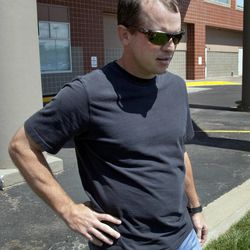 """In this photo taken Aug. 20, 2012, Robert Madison talks about receiving automated marketing calls, outside his office in Overland Park, Kan. Complaints to the government are up sharply about unwanted phone solicitations, raising questions about how well the federal """"do-not-call"""" registry is working. The biggest category of complaint: those annoying pre-recorded pitches called robocalls that hawk everything from lower credit card interest rates to new windows for your home. """"I am completely fed up,"""" Madison said. """"I've repeatedly asked them to take me off their call list."""" When he challenges their right to call, the solicitors become combative, he said. """"There's just nothing that they won't do."""""""