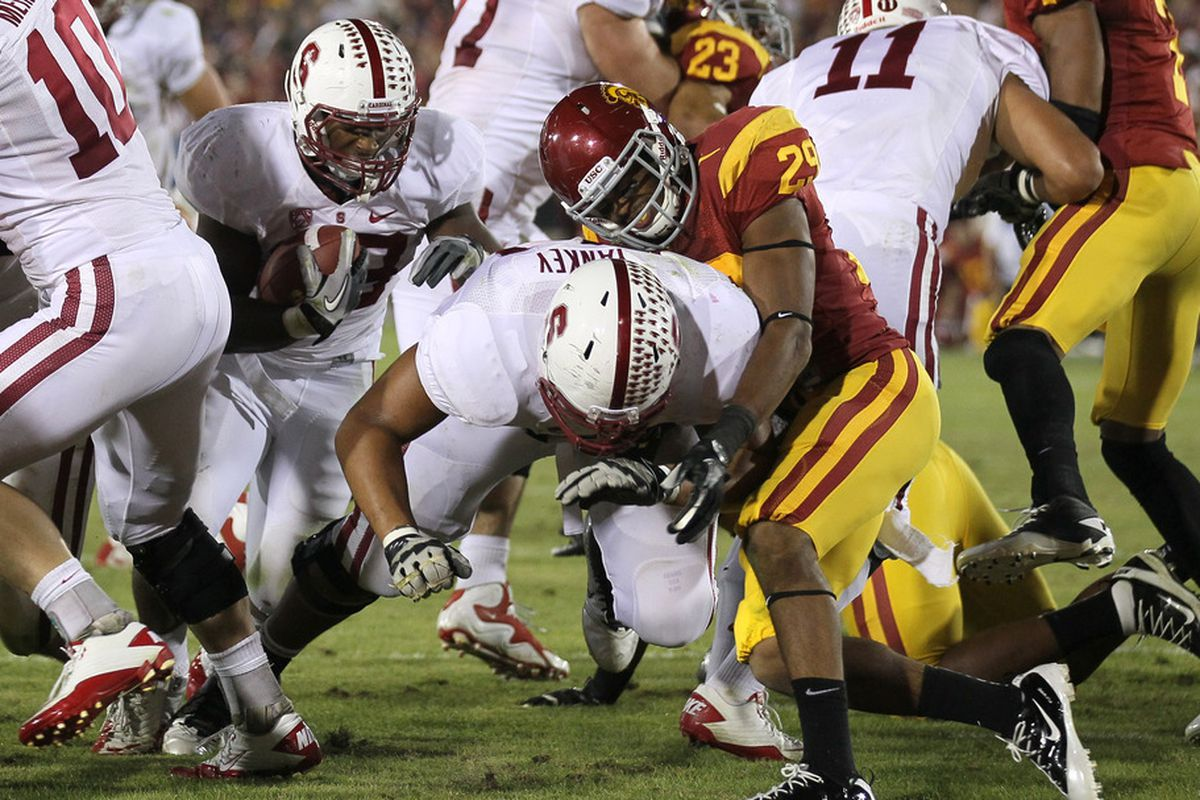 LOS ANGELES, CA - OCTOBER 29: Running back Stepfan Taylor #33 of the Stanford Cardinal carries for a two yard touchdown behind the block of tackle David Yankey #54. Stanford won 56-48 in three overtimes.  (Photo by Stephen Dunn/Getty Images)
