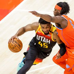 Utah Jazz guard Donovan Mitchell (45) drives against Oklahoma City Thunder forward Luguentz Dort (5) during the game at Vivint Smart Home Arena in Salt Lake City on Tuesday, April 13, 2021.