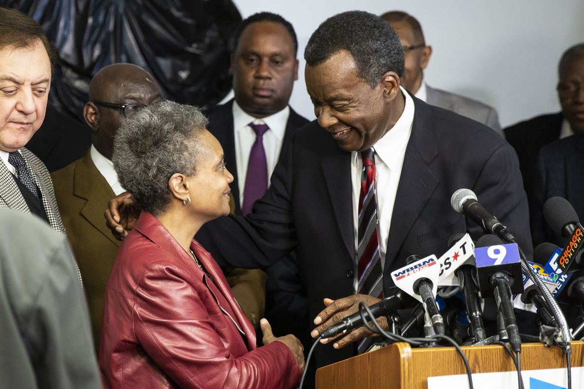 Then-mayoral candidate Lori Lightfoot accepts the powerful endorsement of her former challenger Willie Wilson on March 8.