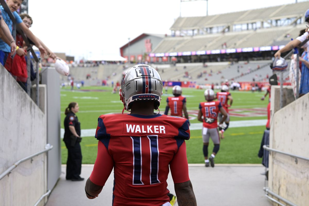 P.J. Walker of the Houston Roughnecks walks on to the field before the XFL game against the St. Louis BattleHawks at TDECU Stadium on February 16, 2020 in Houston, Texas.