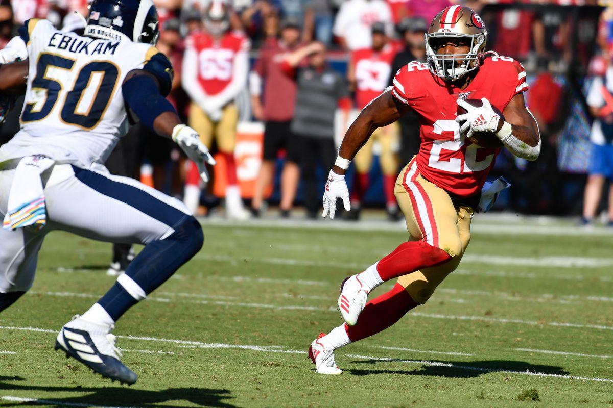 San Francisco 49ers running back Matt Breida tries to run past Los Angeles Rams outside linebacker Samson Ebukam during the second half at Los Angeles Memorial Coliseum.
