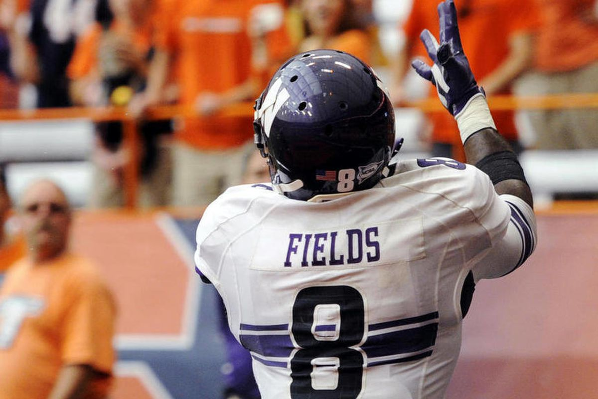 Northwestern's Demetrius Fields (8) makes a catch for a touchdown against Syracuse during the fourth quarter of an NCAA college football game in Syracuse, N.Y., Saturday, Sept. 1, 2012. Northwestern won 42-41.