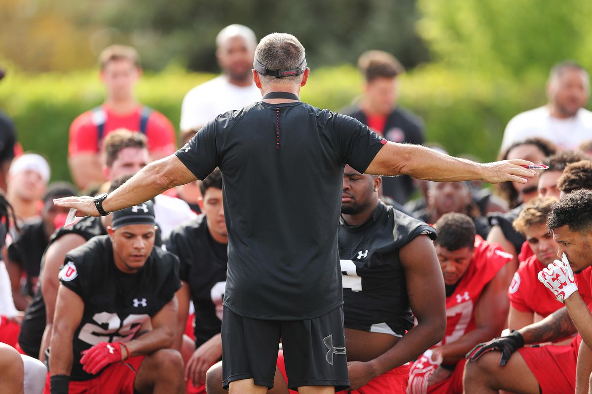 Utah Utes head coach Kyle Whittingham talks with players after practice in Salt Lake City on Aug 2, 2018.