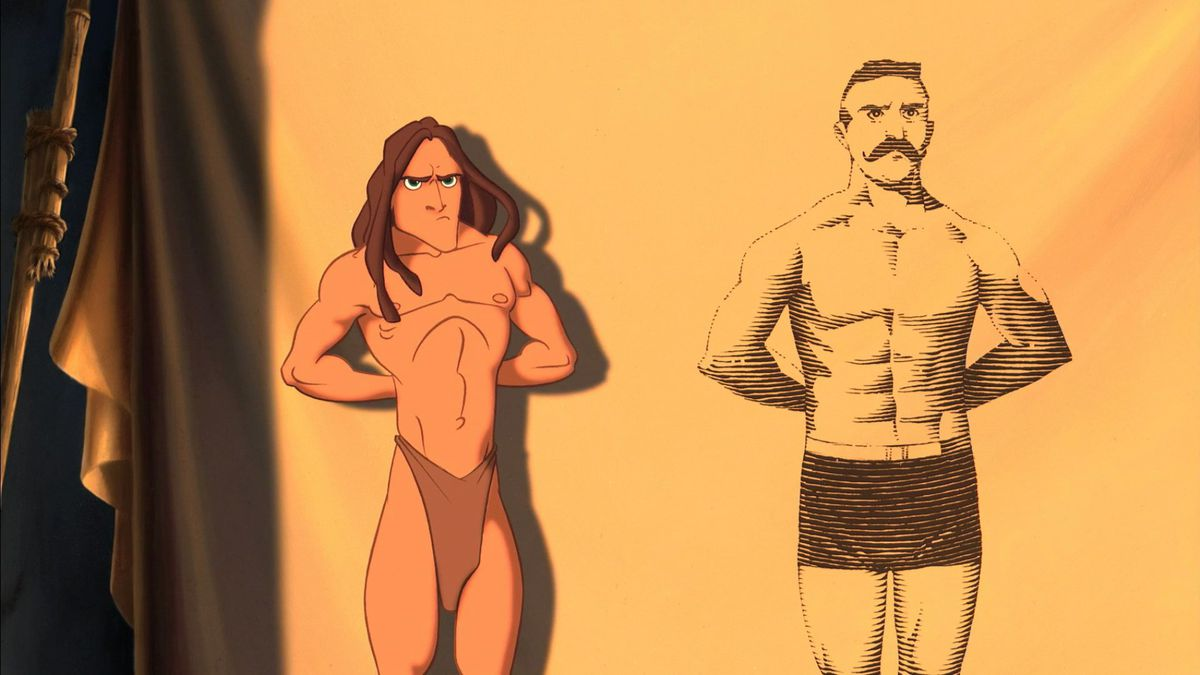 Tarzan stands besides a projected image of a man