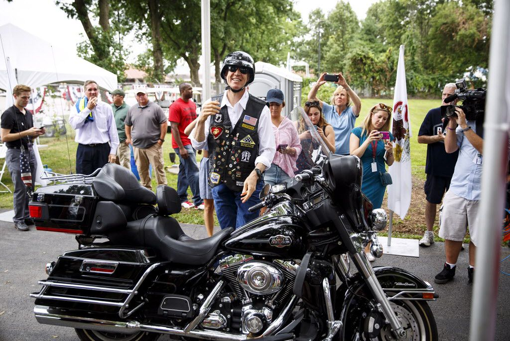 Gov. Bruce Rauner arrives on his motorcycle for the Republican Day rally at the Illinois State Fair in Springfield, Ill. Wednesday, Aug. 16, 2017. (Rich Saal/The State Journal-Register via AP)