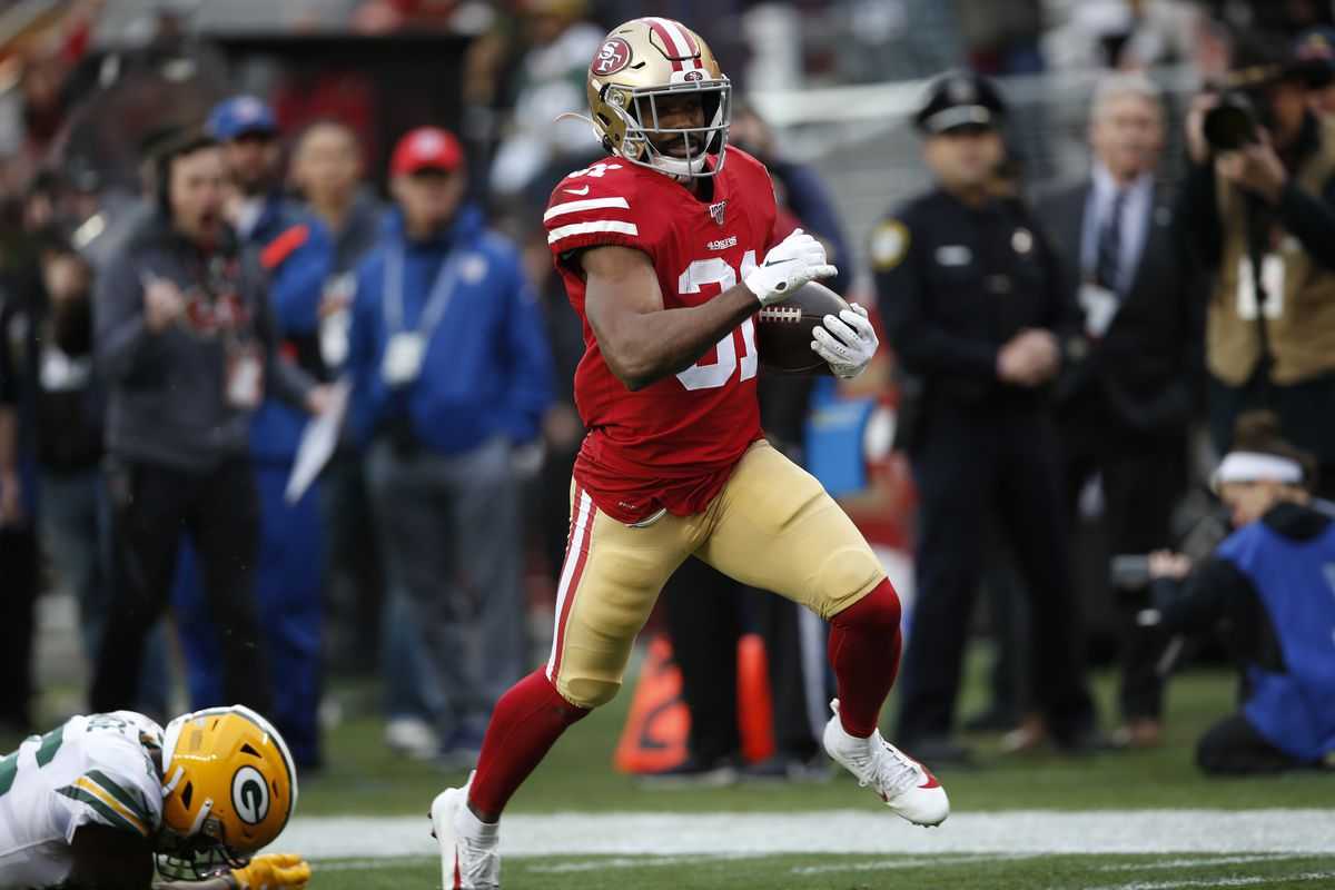 Raheem Mostert of the San Francisco 49ers rushes for a 36-yard touchdown during the game against the Green Bay Packers at Levi's Stadium on January 19, 2020 in Santa Clara, California.