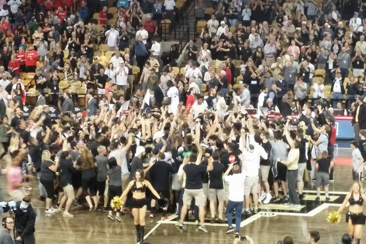 UCF fans rush the floor at CFE Arena following UCF's victory over #15 Cincinnati in Men's Basketball. (Photo: Eric Lopez)