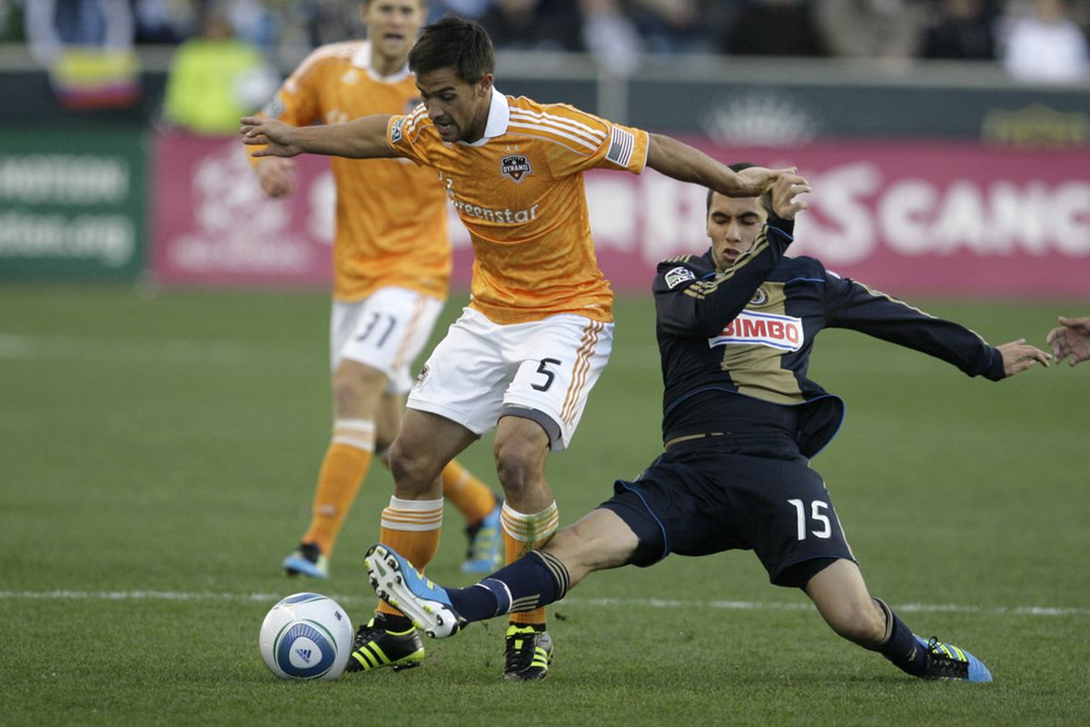 CHESTER, PA - OCTOBER 30: Gabriel Farfan #15 of the Philadelphia Union tackles Danny Cruz #5 of the Houston Dyanmo during an MLS soccer playoff game, October 30, 2011 at PPL Stadium in Chester, Pennsylvania.  (Photo by Chris Gardner/Getty Images)