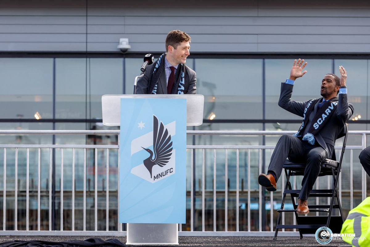 March 18, 2019 - Saint Paul, Minnesota, United States - Minneapolis Mayor Jacob Frey demonstrates his enthusiasm is a step up from Saint Paul Mayor Melvin Carter during the Allianz Field Scarf Raising Ceremony match at Allianz Field.   (Photo by Seth Steffenhagen/Steffenhagen Photography)