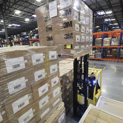 Warehouse workers load supplies as The Church of Jesus Christ of Latter-day Saints prepares to send aid to Chinaat theBishop's Central Storehouse in Salt Lake City, Utah, on Wednesday, Jan. 29, 2020. Respirator masks, protective goggles and protective suits were sent.