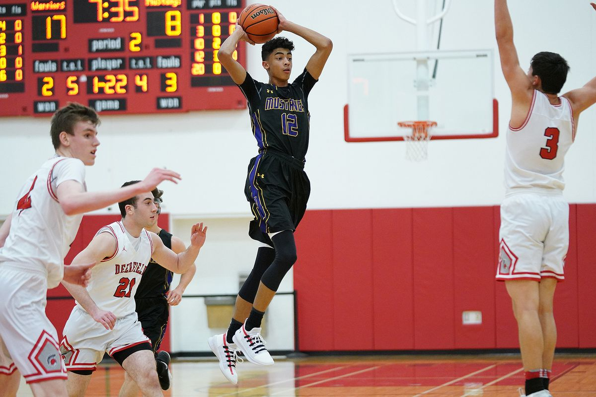 Rolling Meadows' Max Christie (12) jumps up to make a pass.