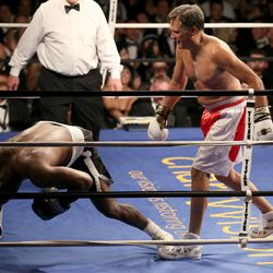 Five-time heavyweight champion Evander Holyfield falls to the ground while fighting former Massachusetts Gov. Mitt Romney at Charity Vision Fight Night at The Rail Event Center in Salt Lake City on Friday, May 15, 2015.