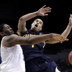 California's Justin Cobbs, right, is fouled by UCLA's Joshua Smith during the first half of an NCAA college basketball game in Los Angeles, Saturday, Feb. 11, 2012.
