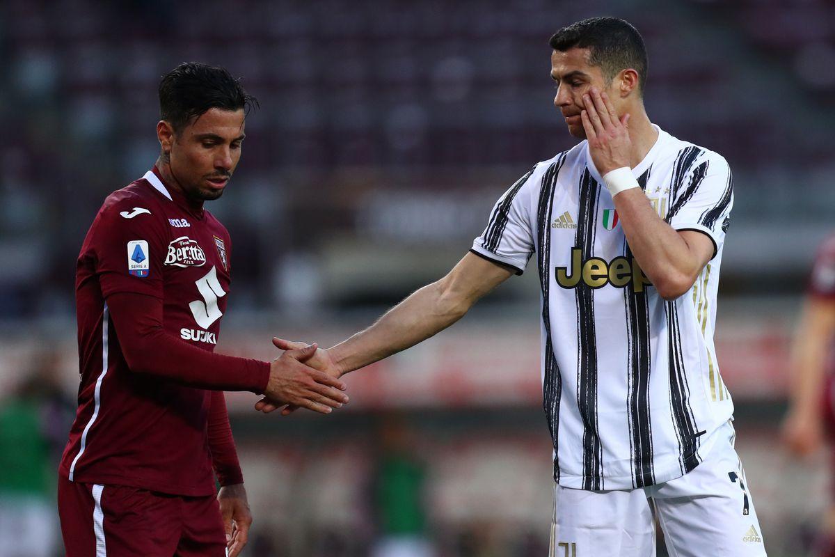 Cristiano Ronaldo of Juventus Fc (R) shake hands with...