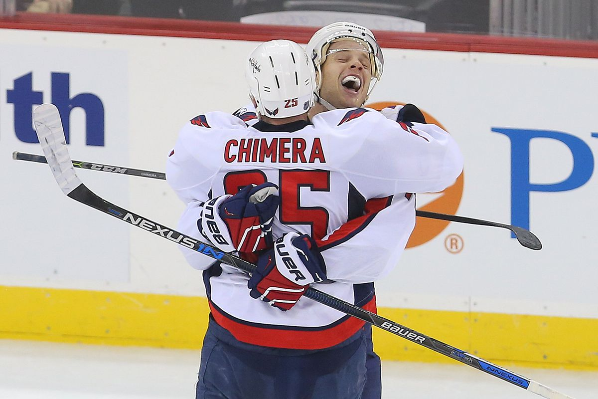 Happy hugs for all the Caps.  They're guaranteed home ice through the Eastern Conference playoffs.
