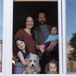 The Anderes family stands together inside their home, Thursday, April 30, 2020.