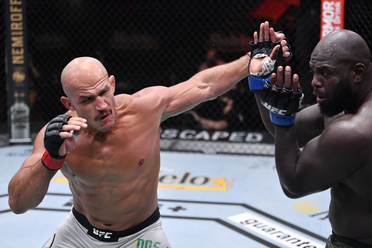 In this handout image provided by UFC, Junior Dos Santos of Brazil punches Jairzinho Rozenstruik of Suriname in their heavyweight bout during the UFC 252 event at UFC APEX on August 15, 2020 in Las Vegas, Nevada.