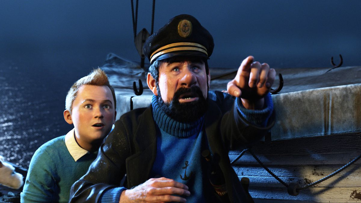 Captain Haddock points with Tintin looking on from behind in The Adventures of Tintin