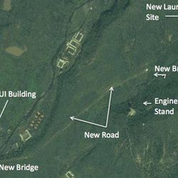 In this satellite image taken Aug. 29, 2012 by DigitalGlobe and provided Monday, Sept. 24, 2012 by 38 North, the website of the U.S.-Korea Institute at Johns Hopkins School of Advanced International Studies, a structure which an analyst says a unfinished rocket launch site, top right, and other major new facilities at the Tonghae launch complex are seen near the village of Musudan-ri on the northeast coast of North Korea. North Korea has stopped construction on a launch pad where intercontinental-range rockets could be tested, an interruption possibly due to heavy rains and that could stall completion up to two years, according to the analysis of Aug. 29 images provided to The Associated Press by 38 North.
