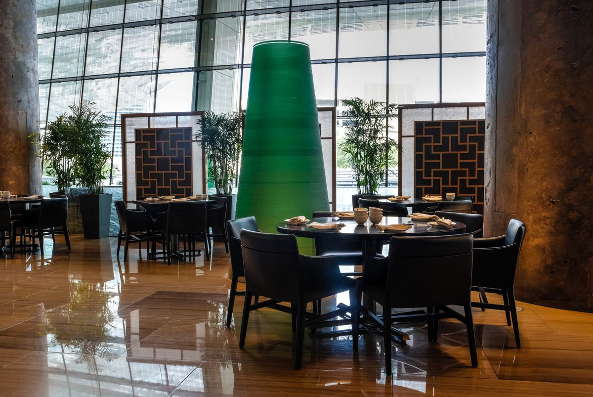 A dining room with green spheres