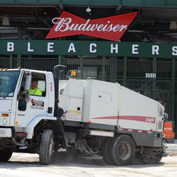 2:23 p.m. Another view of the street sweeping truck outside the main bleacher gate -