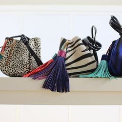 Colorful accents: A bright, colorful accessory is the perfect addition to any outfit. We love these suede and leather animal print pouches with tassels by Vanessa Bruno.