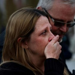 Jamie Brewer cries after being united with her daughter after a lockdown at the high school was lifted Thursday, Dec. 3, 2015. Pleasant Grove High School was placed on lockdown after receiving reports of a man with a weapon inside the school.