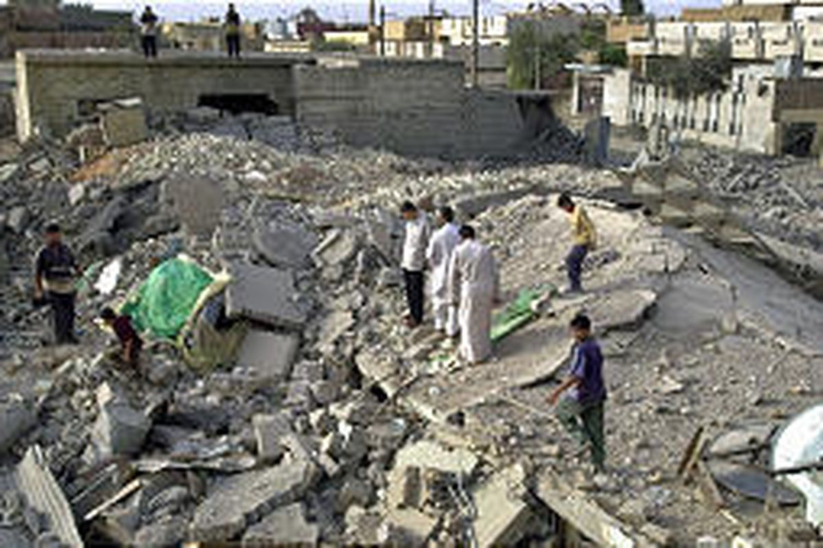 Iraqis search through the rubble of a destroyed house after U.S. warplanes pounded Fallujah in a campaign to kill or capture the terrorist leader al-Zarqawi and his followers.