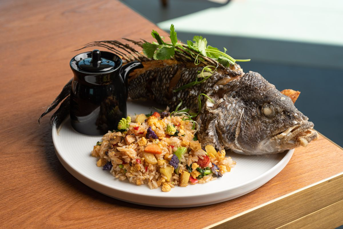 Crispy black sea bass with vegetable fried rice.